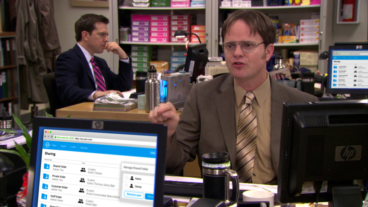 Dwight arguing with a coworker. Sync is shown on their computer.